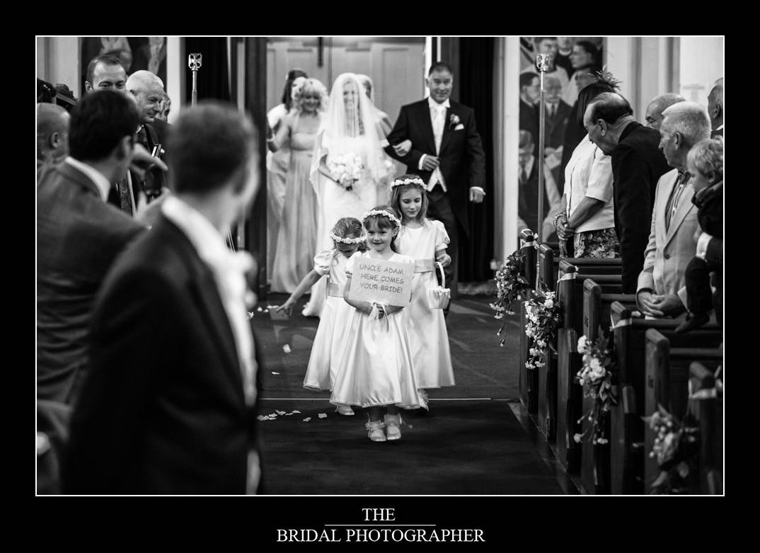 flower girls walking down the aisle at a wedding