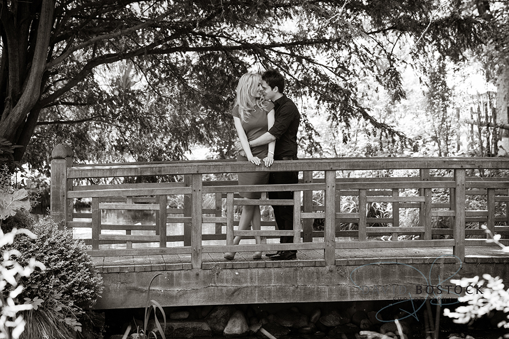 Le manoir engagement shoot black and white on bridge