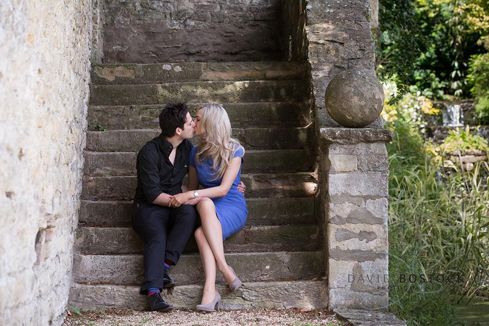 Le manoir engagement shoot kissing on steps