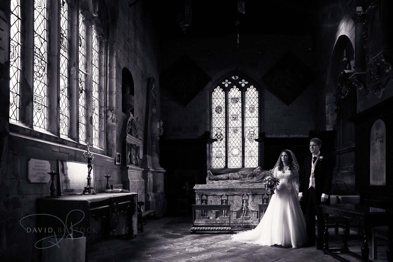 bride and groom in church in black and white