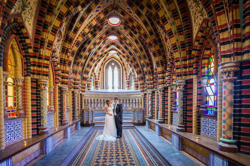 bride and groom in beautiful chapel