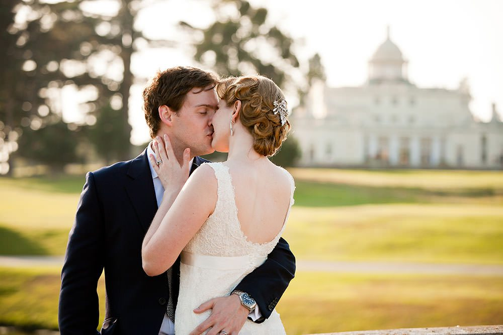 bride and groom kissing in the late afternoon at Stoke Park Club