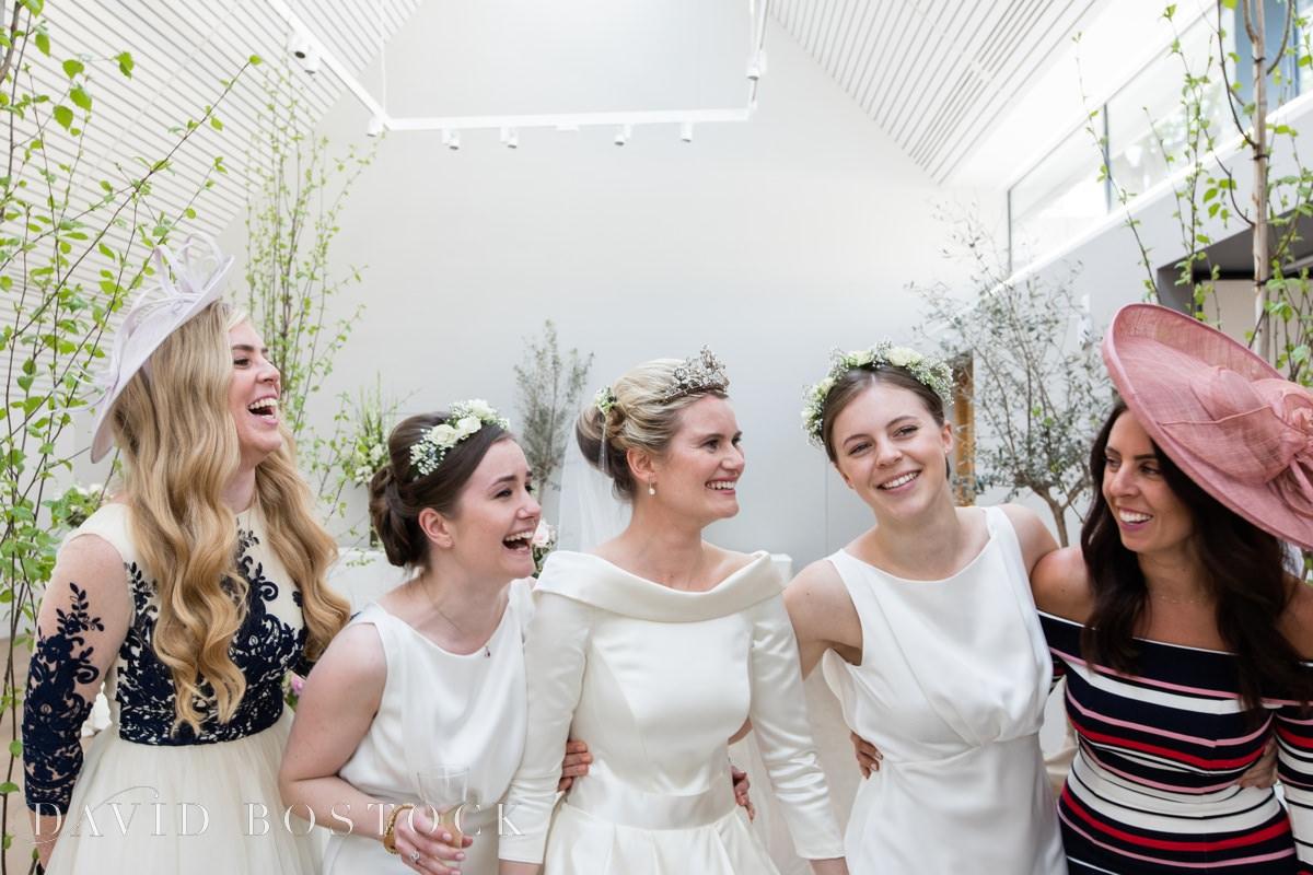 Bridesmaid and bride laughing