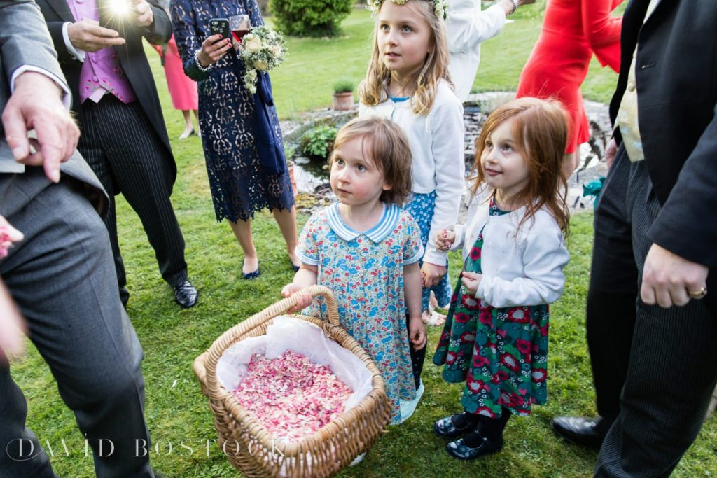 flower girls with confetti
