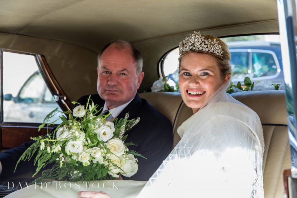 Bride in car with father