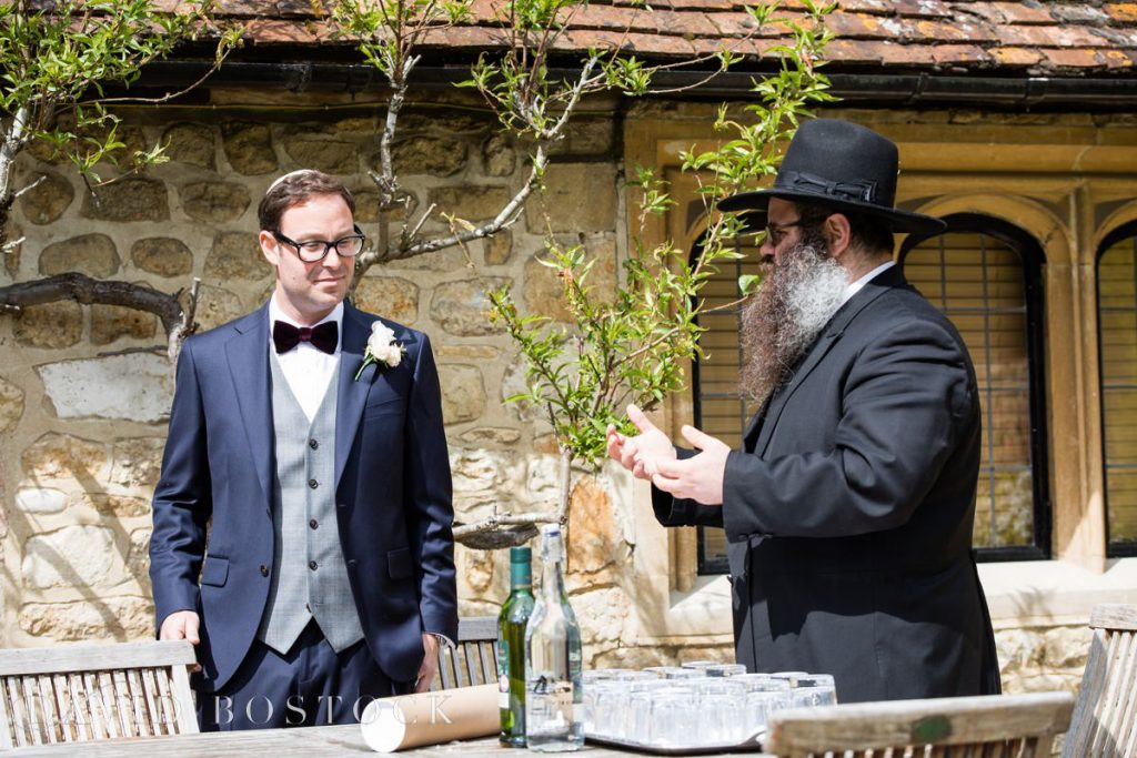 Rabbi and groom