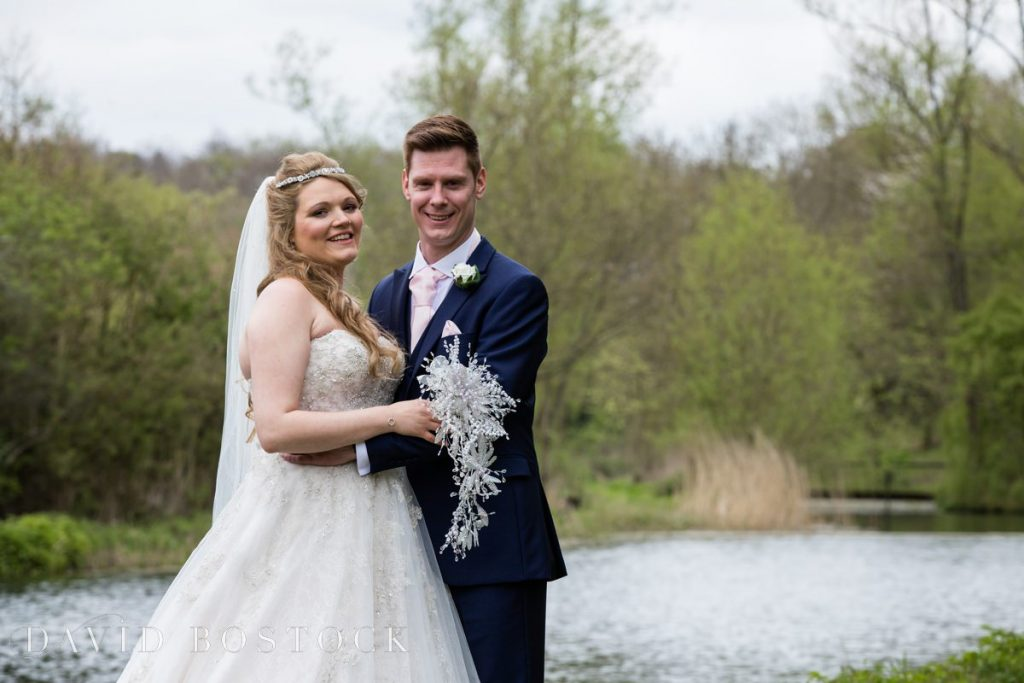 couple in front of lake close up