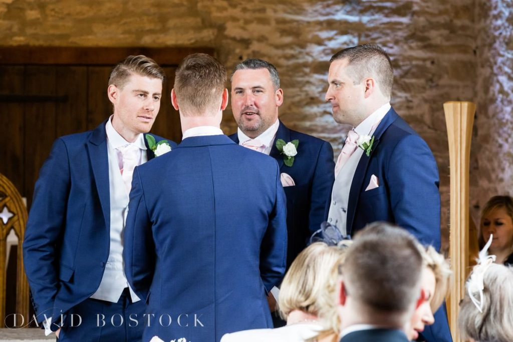 groomsmen at alter