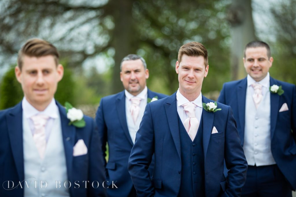the groomsmen in navy suits