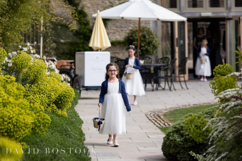 Caswell House Spring Wedding flower girls on aisle