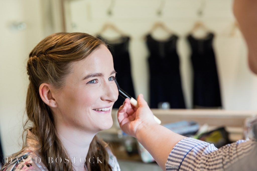 Caswell House Spring Wedding bride having makeup done