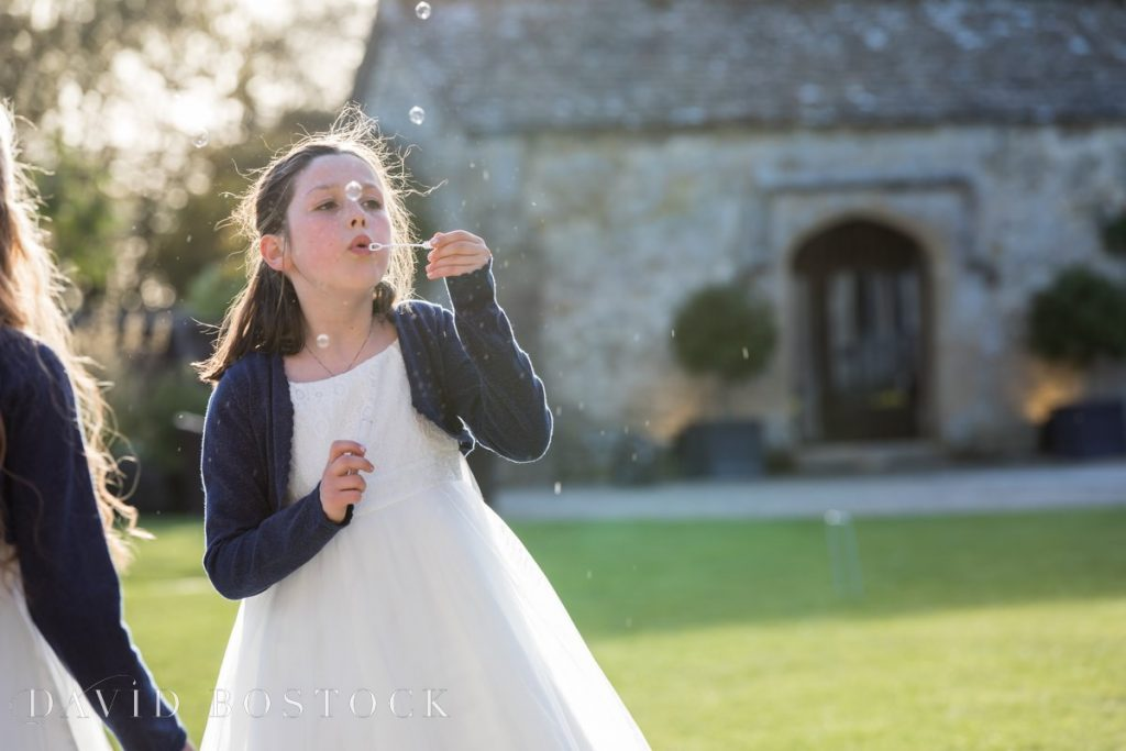 Caswell House Spring Wedding child blowing bubbles