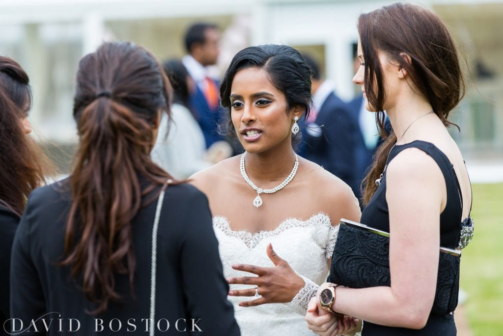 Eynsham Hall Wedding bride talking to guests