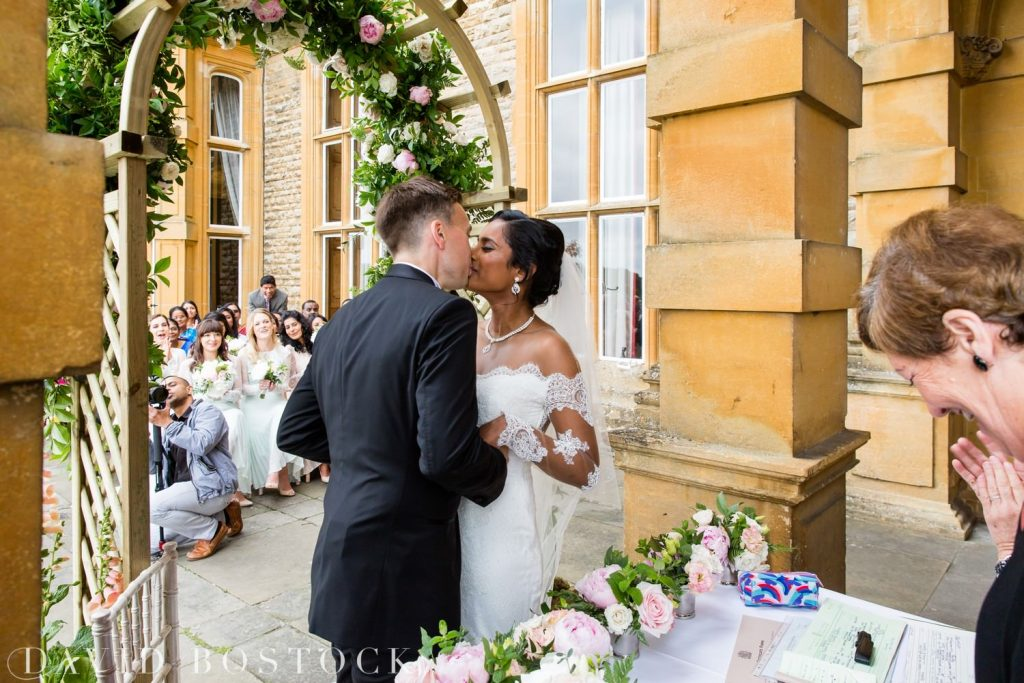 Eynsham Hall Wedding couple kissing