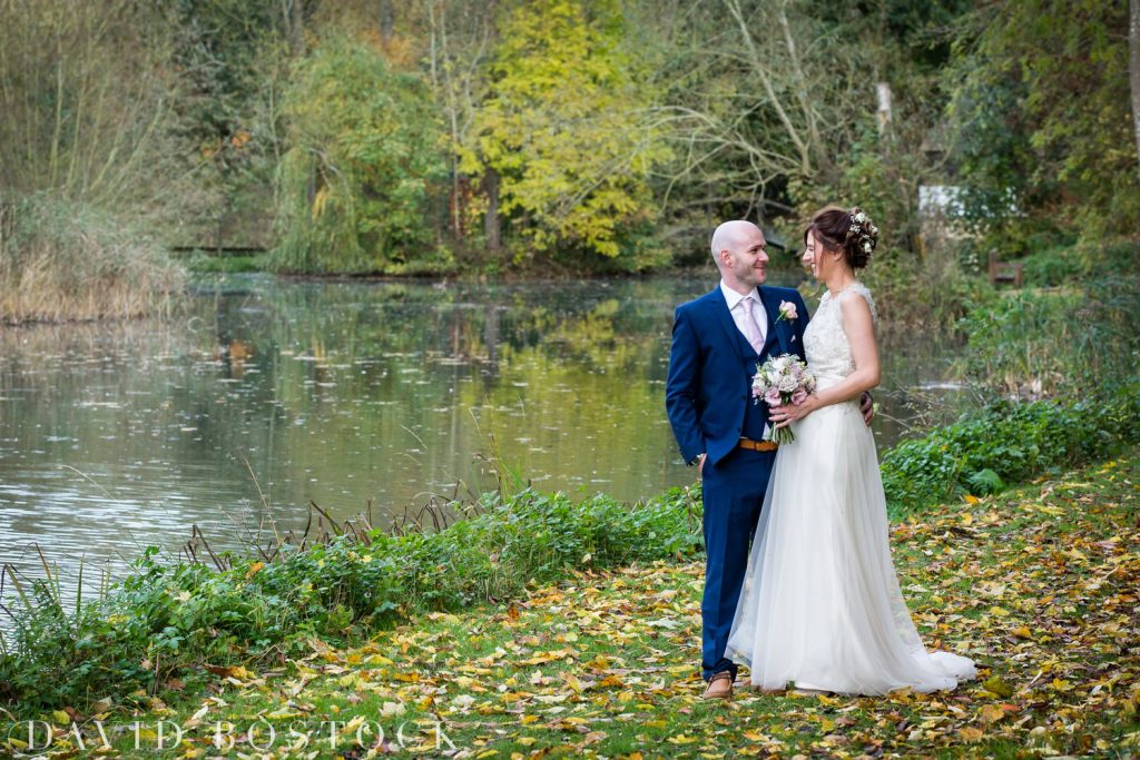 The Great Barn Aynho Wedding Photographs bride and groom by lake