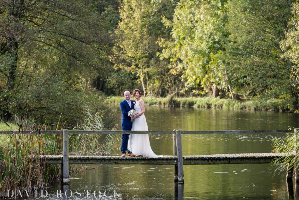 The Great Barn Aynho Wedding Photographs bride and groom on lake