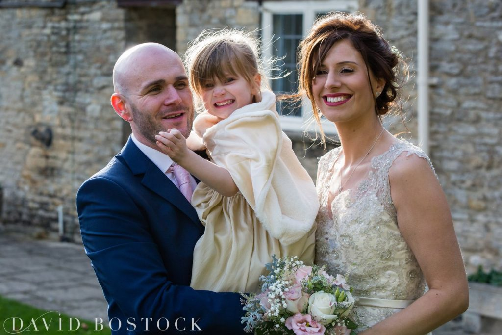 The Great Barn Aynho Wedding Photographs bride and groom with daughter