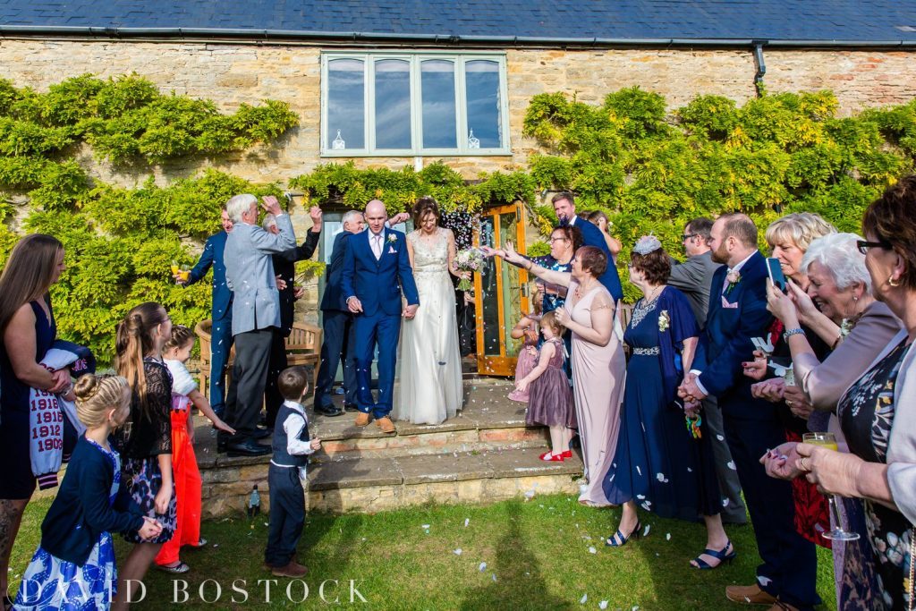 The Great Barn Aynho Wedding Photographs confetti shot