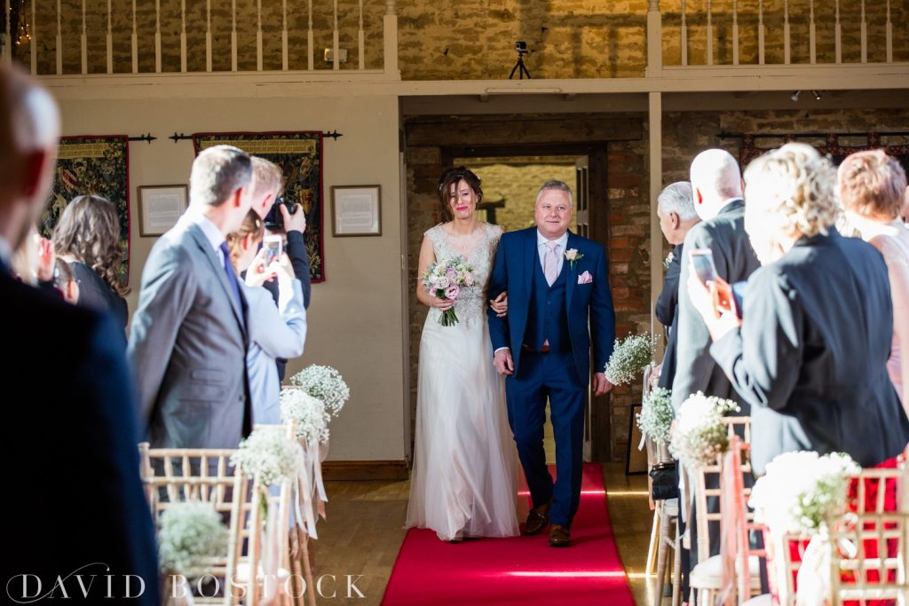 The Great Barn Aynho Wedding Photographs bride on aisle