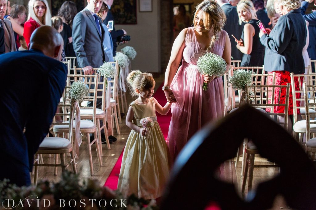 The Great Barn Aynho Wedding Photographs flower girl on aisle