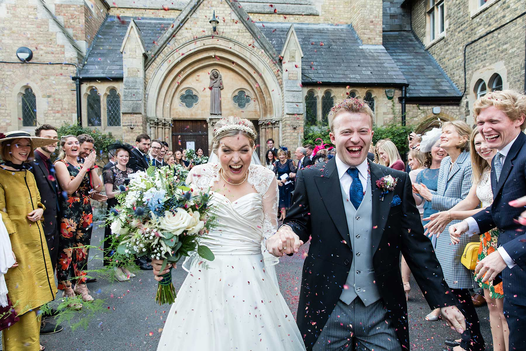 bride and groom with confetti at their oxford wedding