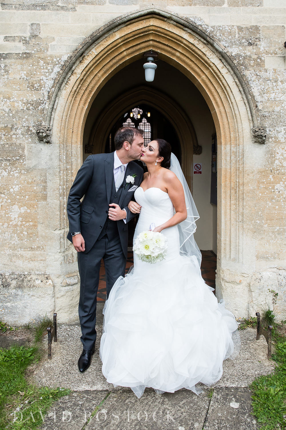 Oxfordshire church wedding kiss photo