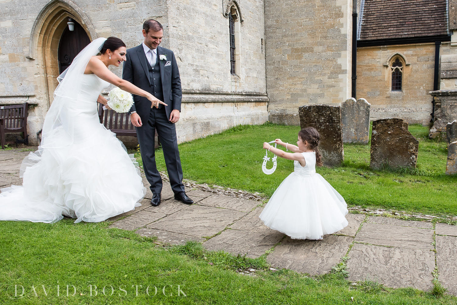 Oxfordshire wedding photography bride and groom and flower girl