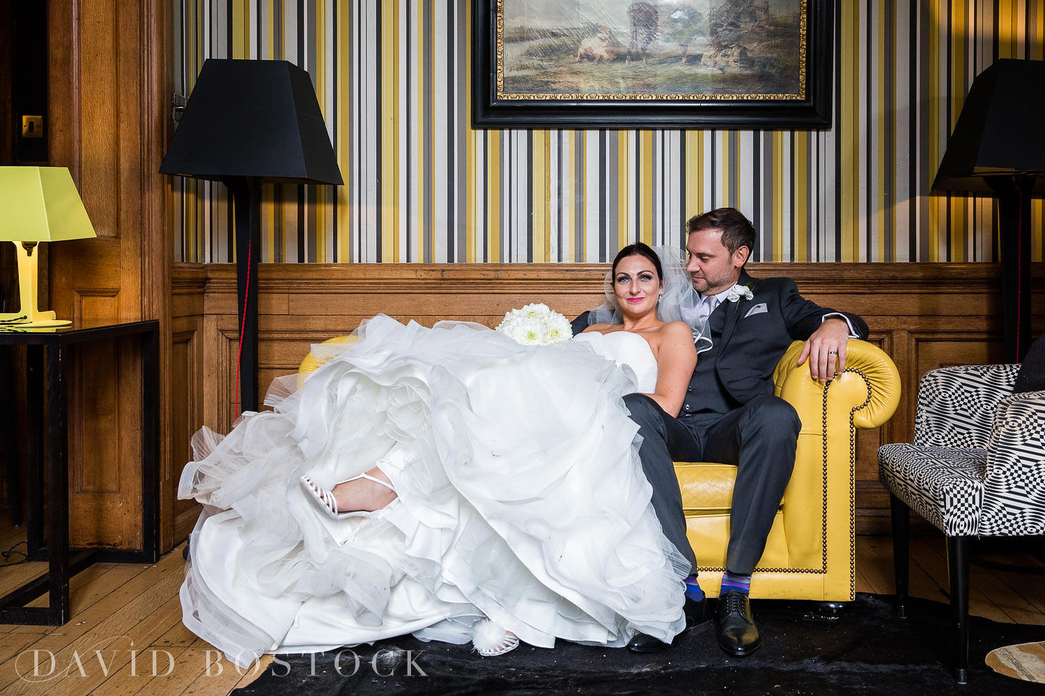 Eynsham Hall Gun Room bar bride and groom photo