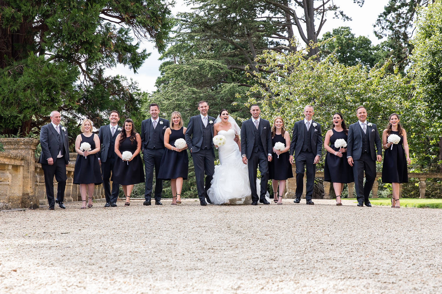 Eynsham Hall wedding photo bridal party fun