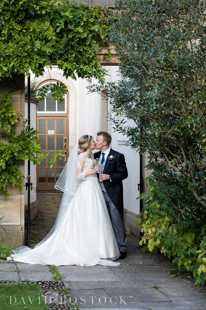 Ashmolean wedding Regents Park College bride and groom kissing
