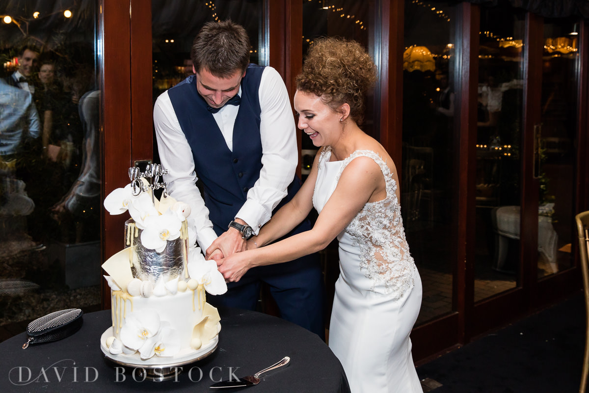 The Crazy Bear bride and groom cutting cake