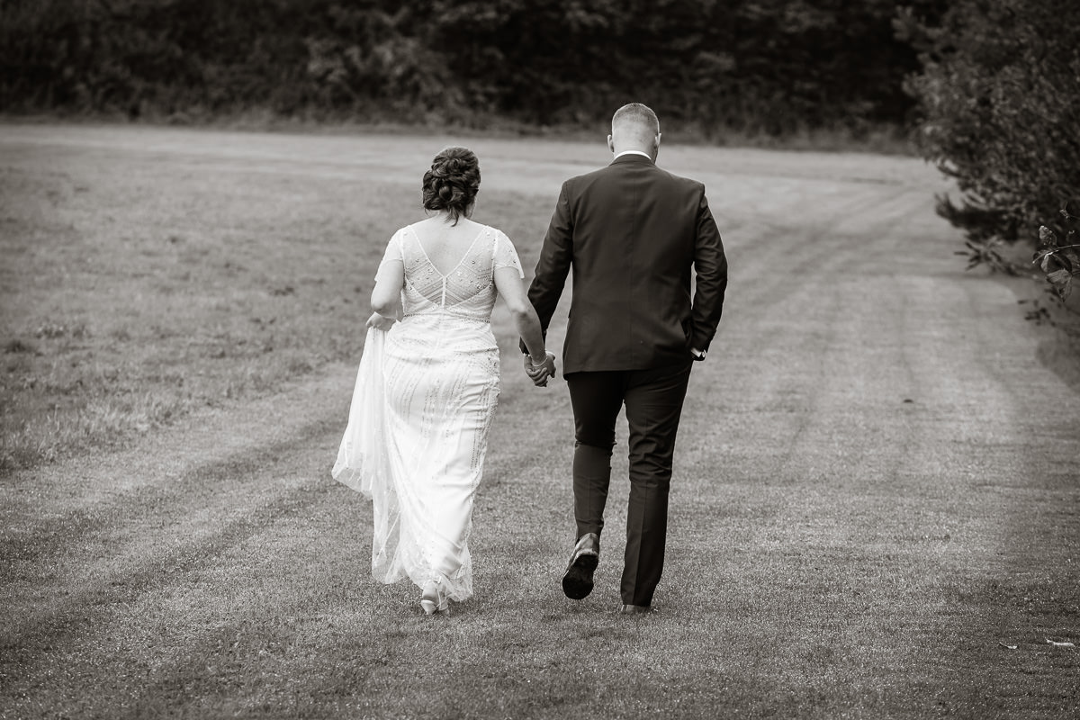 Cripps Barn wedding bride and groom walking
