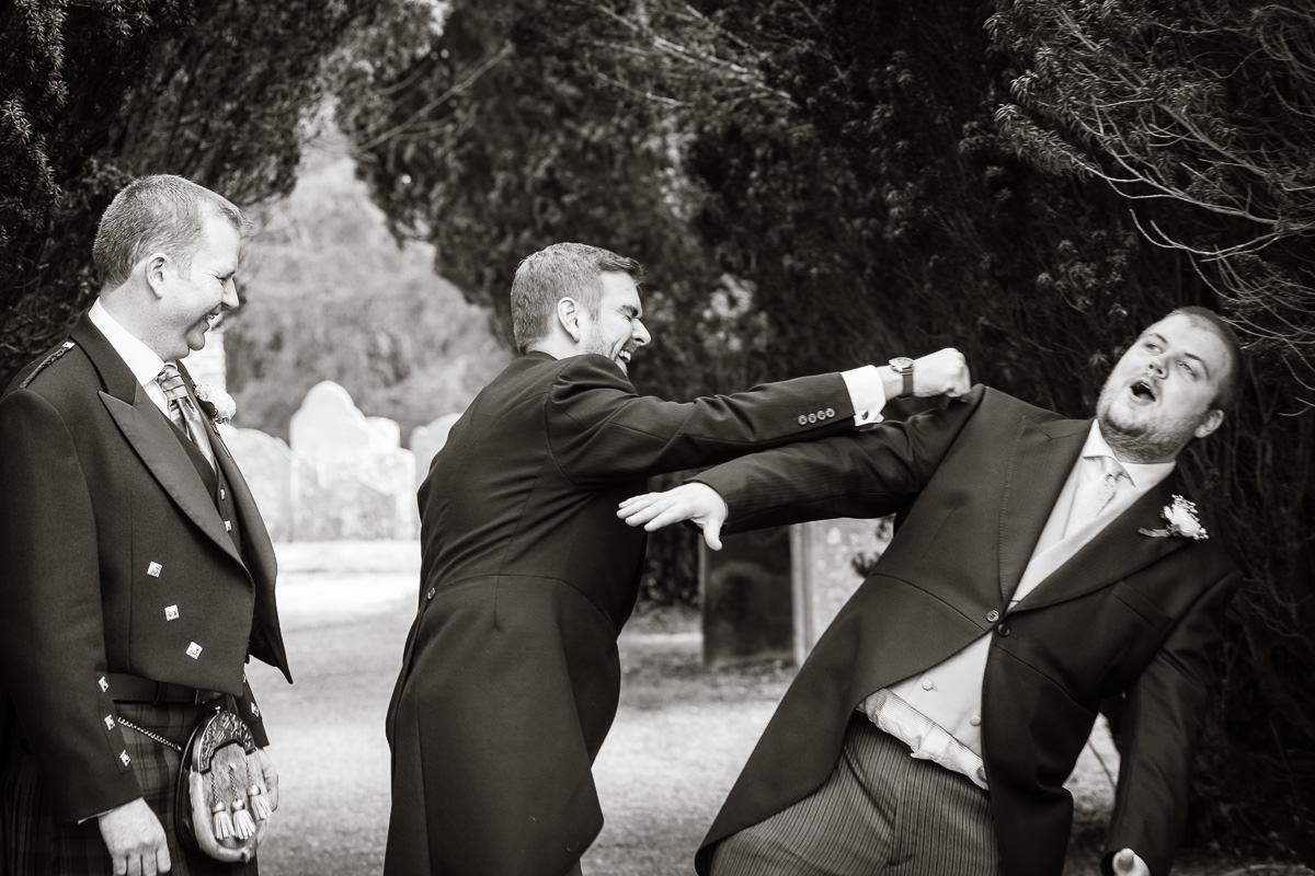 Ardington House wedding groomsmen laughing