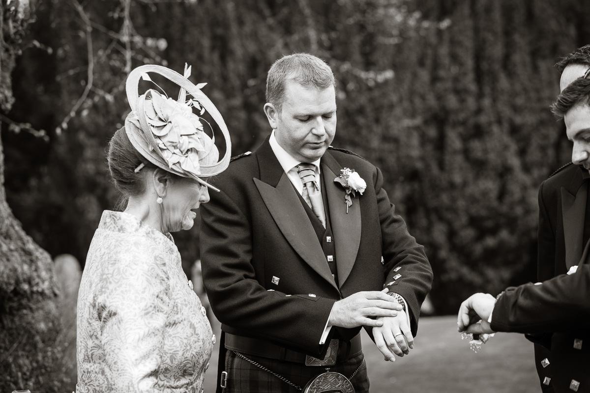 Ardington House wedding checking watches
