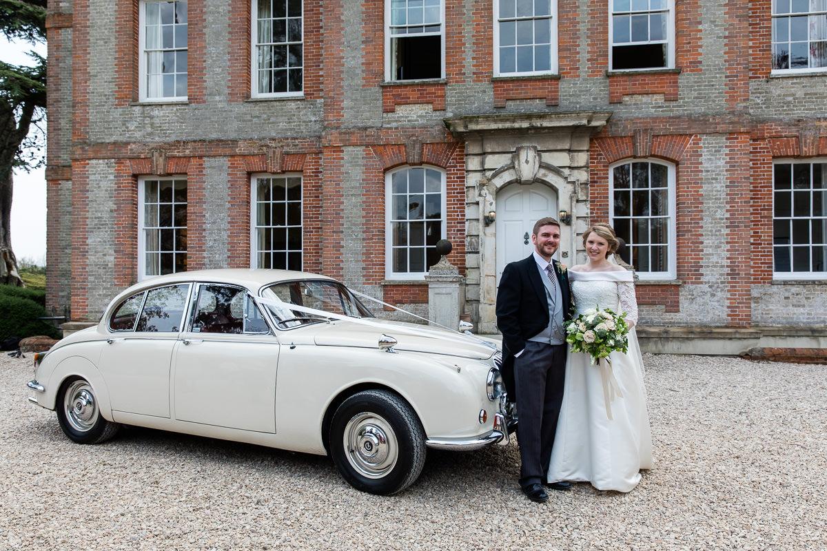 Ardington House wedding posing with car