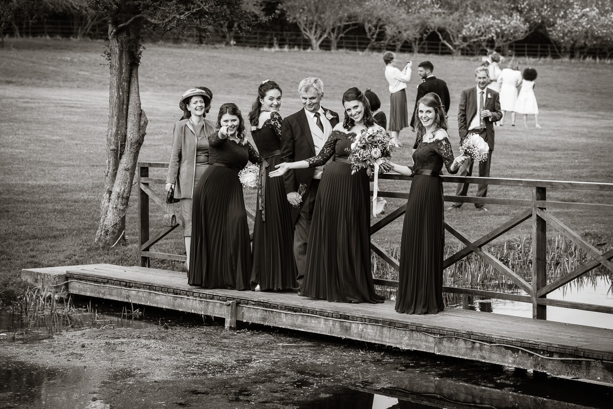 Ardington House wedding bridesmaids on bridge