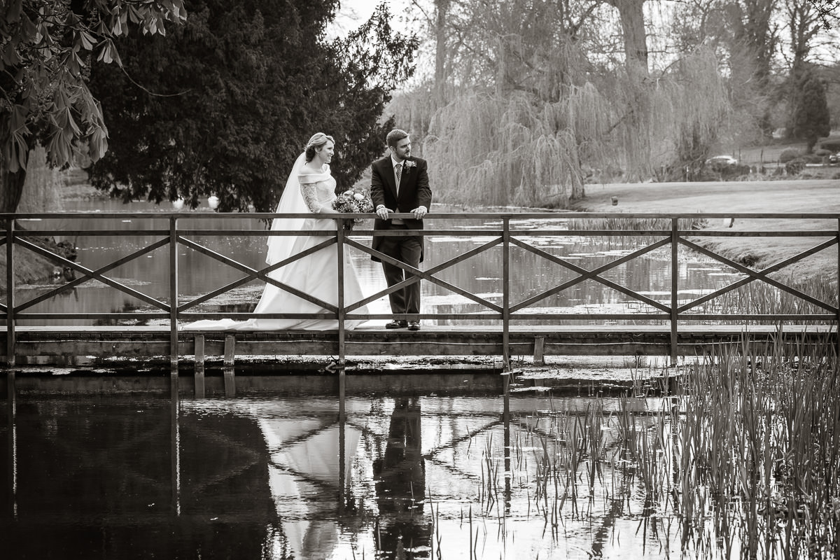 Ardington House wedding bride and groom on bridge