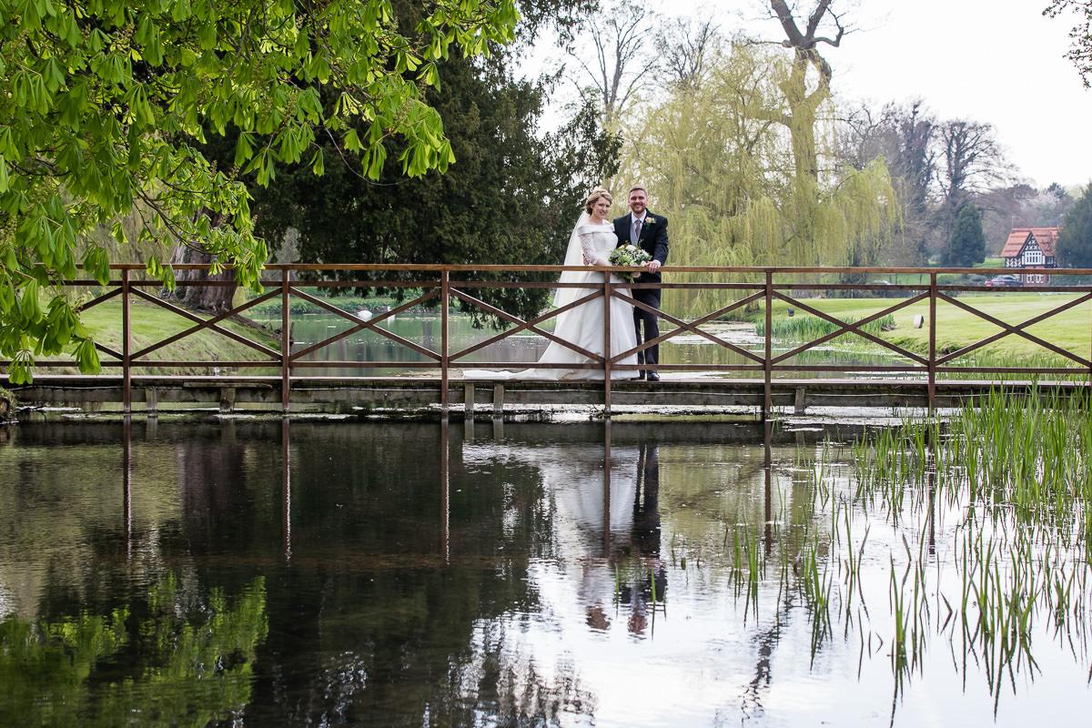 Ardington House wedding bride and groom on bridge smiling