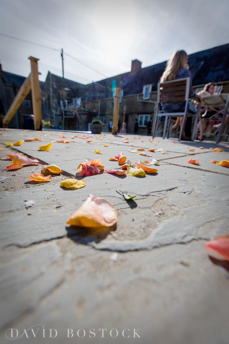 The Great Barn Aynho wedding confetti on ground