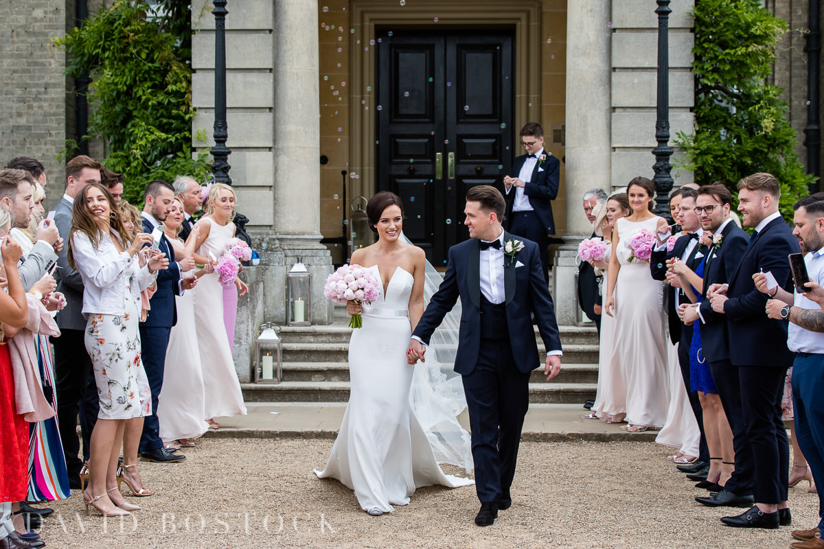 Hedsor House wedding blowing bubbles