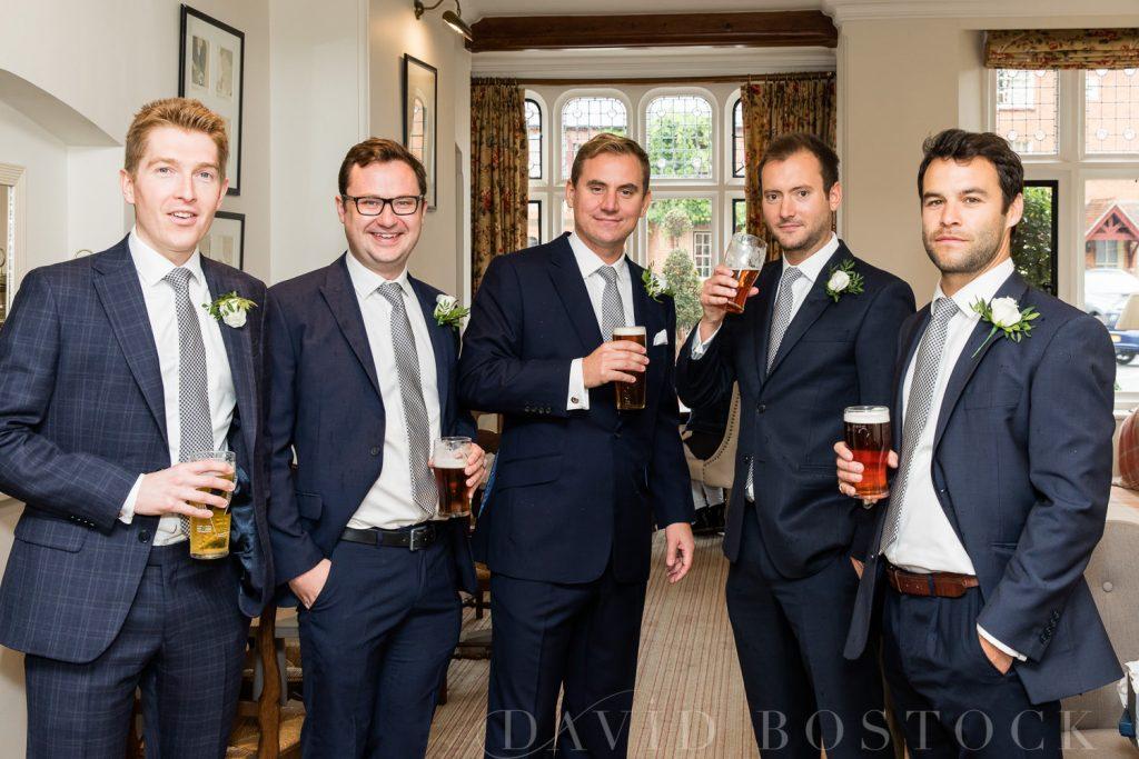 The Dairy Waddesdon wedding groomsmen drinking