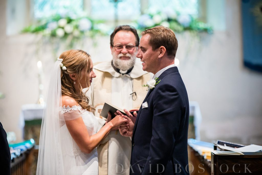 The Dairy Waddesdon wedding couple exchanging rings