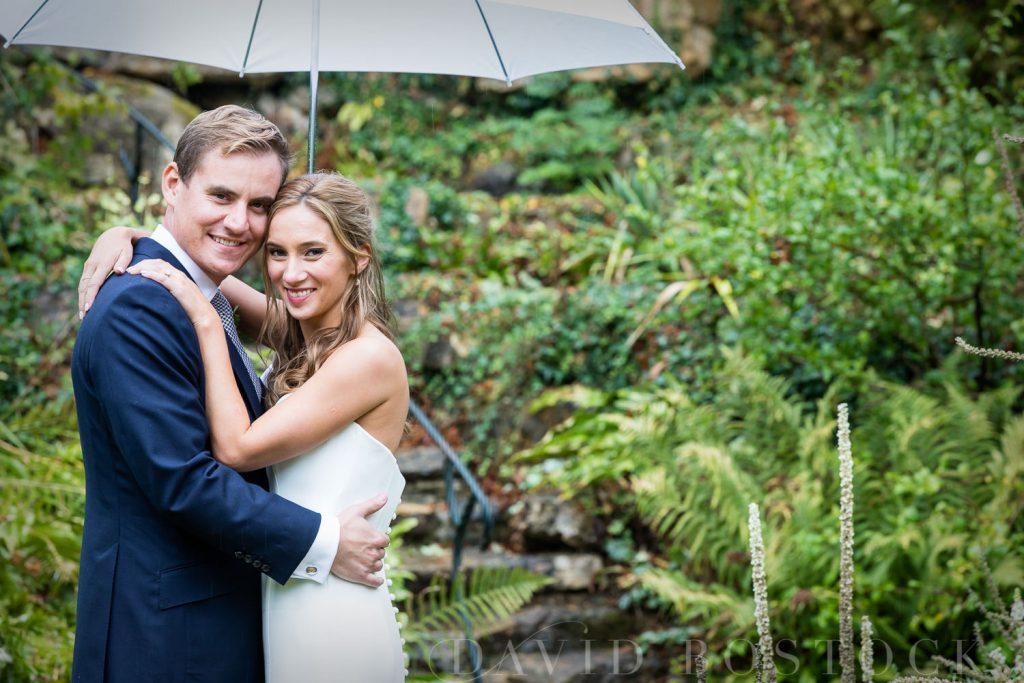 The Dairy Waddesdon wedding bride and groom rainy day