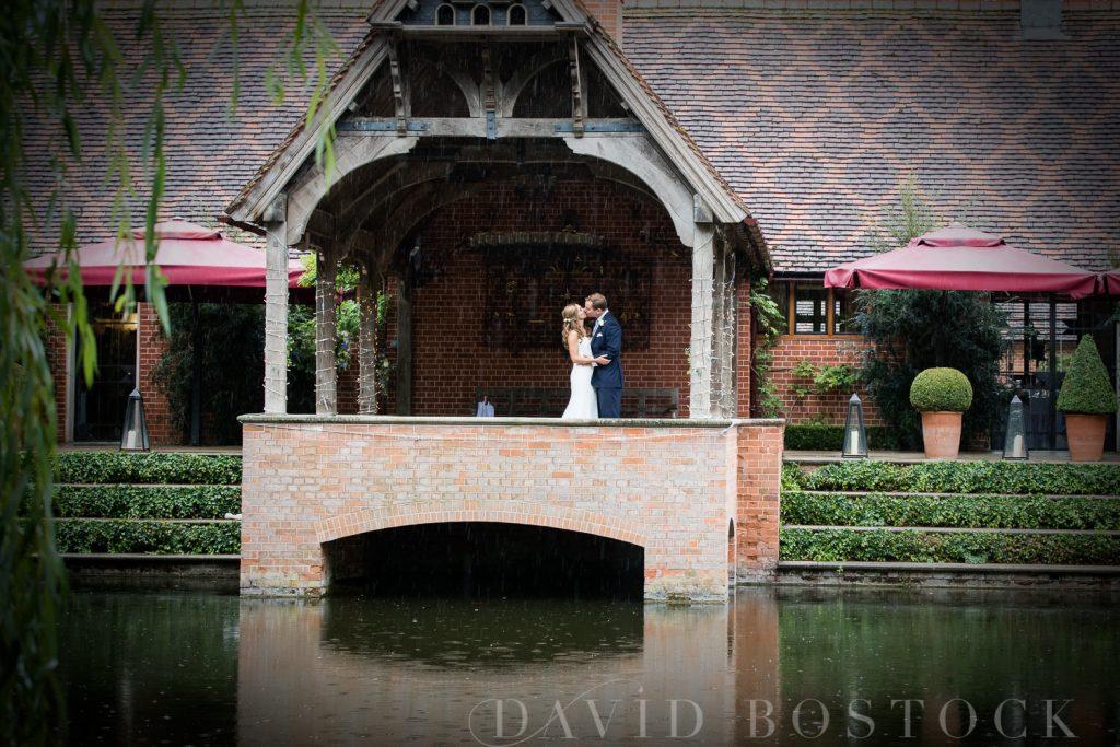 The Dairy Waddesdon wedding bride and groom across lake