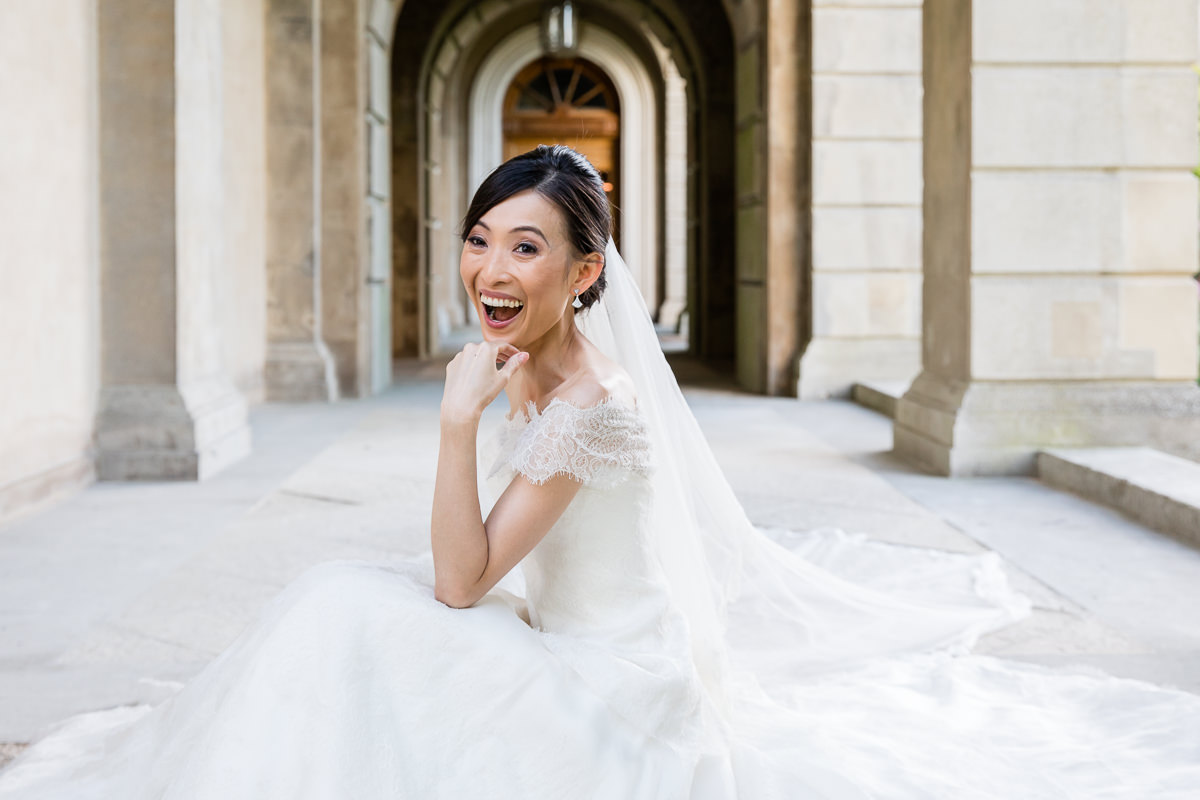 BRIDE LAUGHING AT CLIVEDEN HOUSE