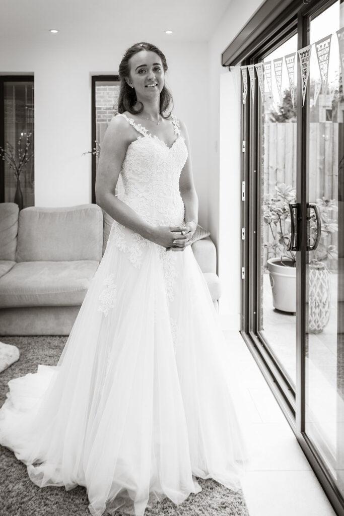 bride standing in wedding dress
