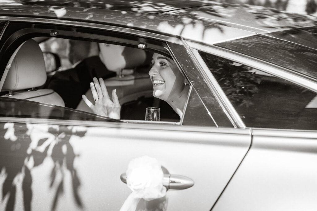 BRIDE AND GROOM LEAVING IN WEDDING CAR