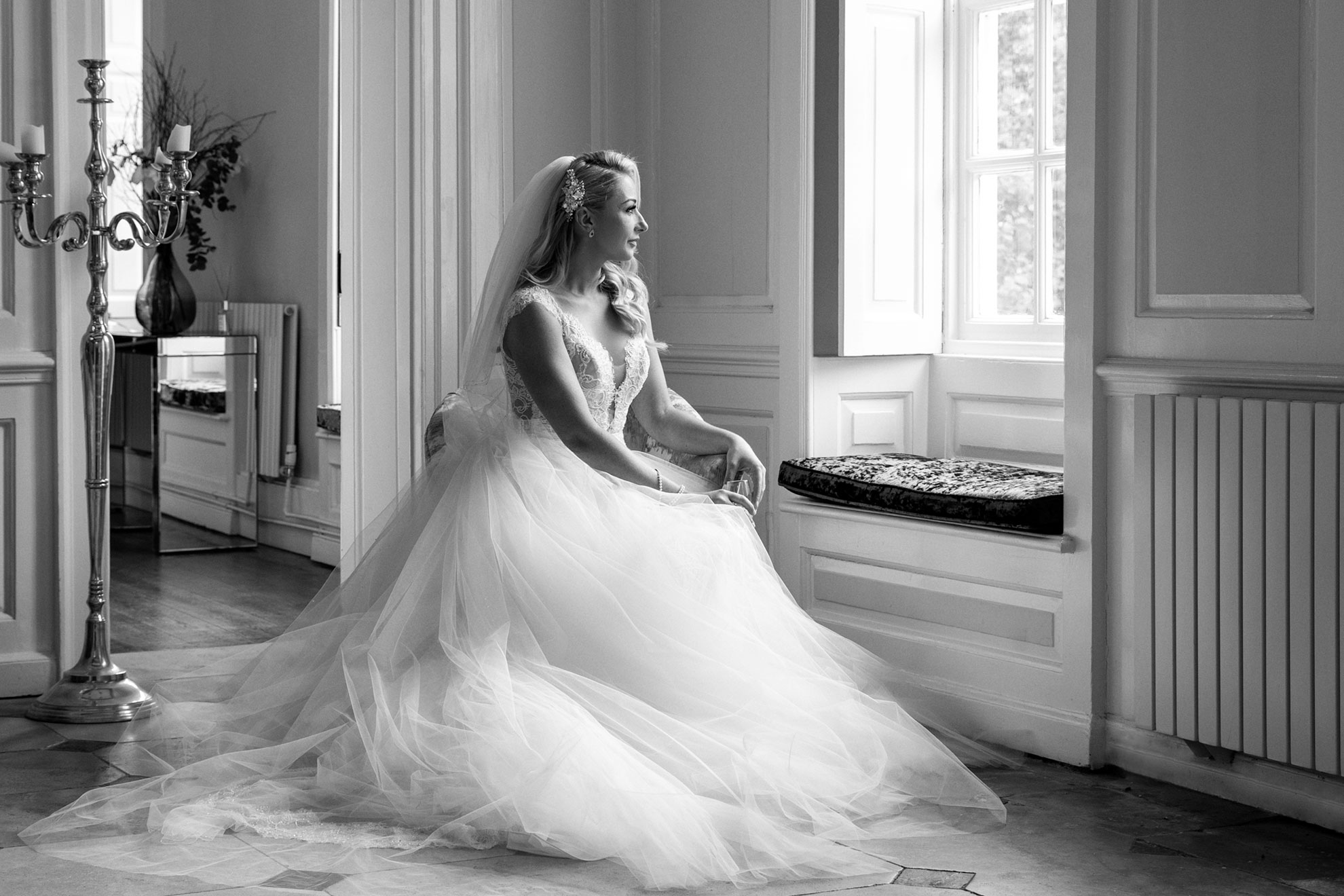 bride sitting looking out of window